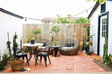 Contemporary small patio ideas with black and white bistro set and lounge chairs
