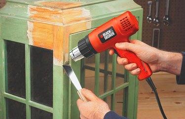 Heat gun stripping paint.