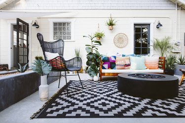 Patio furniture on black and white rug