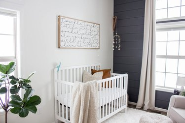 blue nursery idea with shiplap accent wall and drapery at window