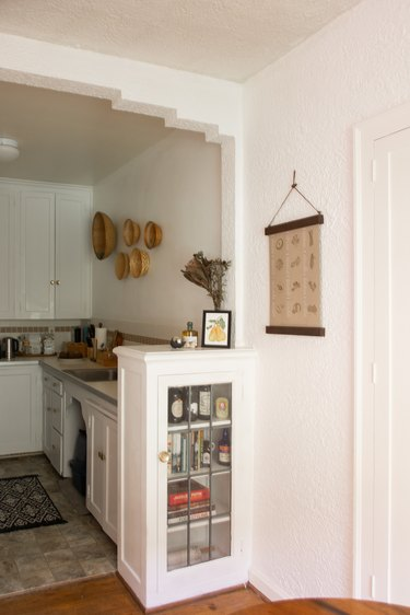 Kitchen view with hanging baskets on wall