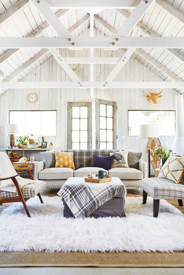 living room with whitewashed a-frame interior and plaid accent decoro