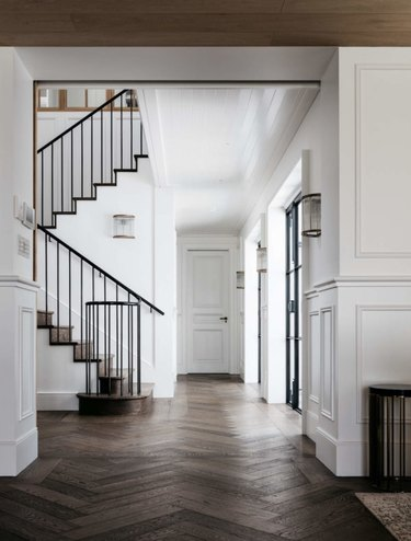 hallway with herringbone pattern wood flooring
