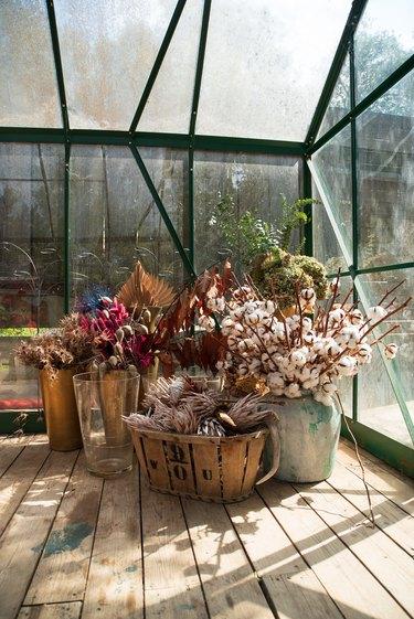 Bundles of flowers in greenhouse