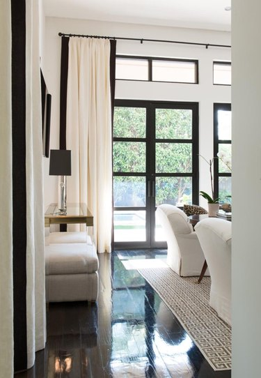 white and black living room with high gloss wood flooring