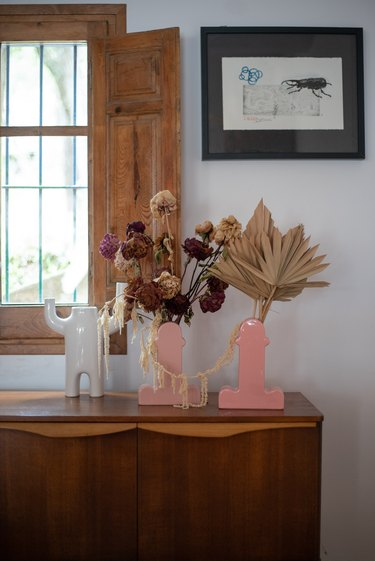 Pink vases with dried flowers
