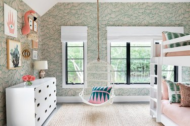 green kids bedroom idea with abstract wallpaper, swing chair