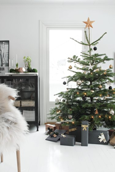 minimalist Christmas tree with gold and silver decorations