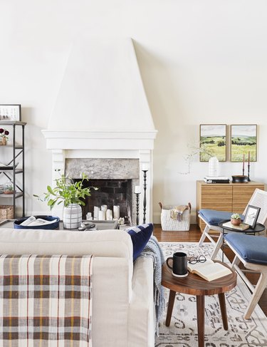 traditional living room with beige couch with plaid throw draped over the back