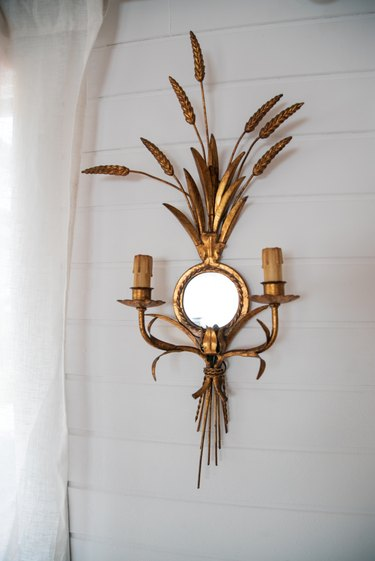 Brace, ornamental sconce with mirror