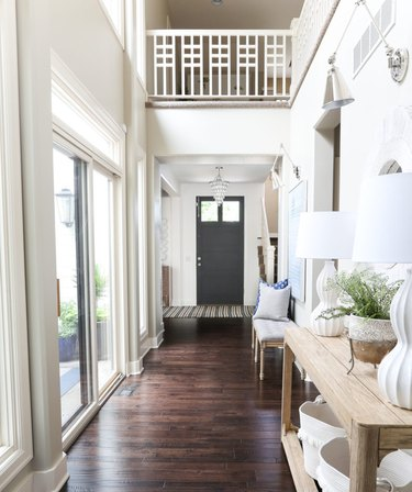 hallway with wood flooring in varying sizes