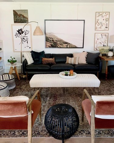 living room rug idea with Persian rug supporting just front legs of  leather furniture
