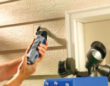 Cutting siding with a rotary tool.