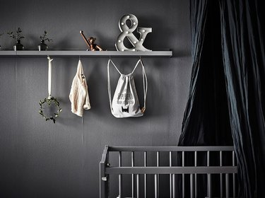 nursery idea for 2020 with dark color palette and ceiling canopy
