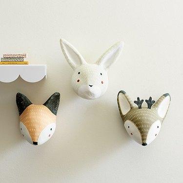 nursery idea for 2020 with stuffed animal heads as wall decor
