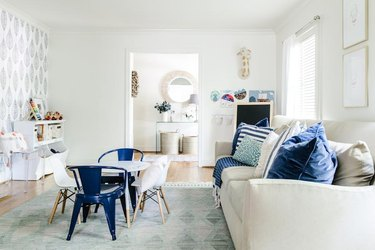 traditional kids playroom idea with large sofa and small table and chairs