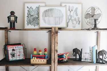 Organized bookshelf playroom storage idea with rustic wooden bookcase