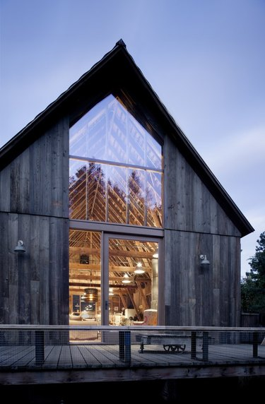 An a-frame barn with floor-to-ceiling windows
