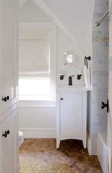 white bathroom with hexagonal cork flooring
