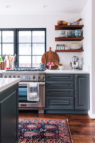 modern kitchen with dark wood cabinets