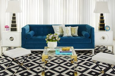 art deco living room with blue couch and patterned rug