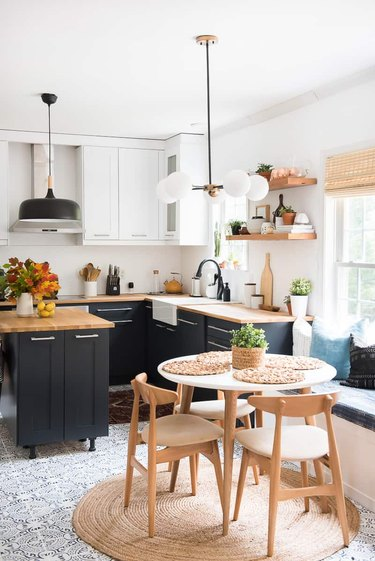 black eat-in kitchen with modern wood table and chairs