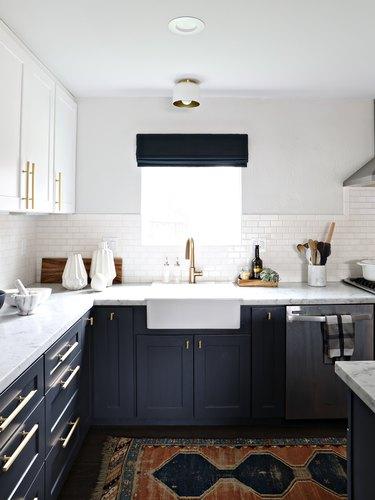 modern kitchen with dark blue wood cabinets