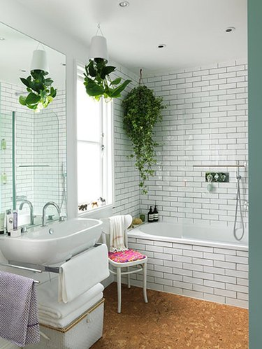 bohemian white bathroom with cork flooring and hanging plants
