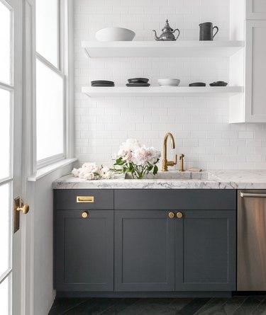 modern kitchen with gray wood cabinets and subway tile backsplash
