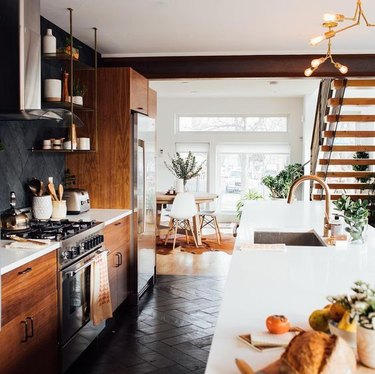 modern kitchen with dark wood cabinets and open shelving