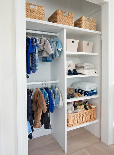 nursery organization in closet with custom shelving and double rods