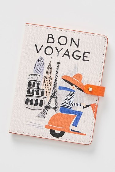 passport holder with bon voyage text on the outside
