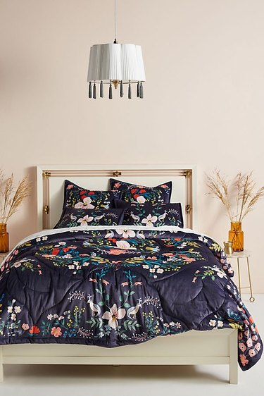 bed with floral patterned sheets