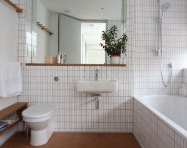 minimalist white bathroom with cork flooring