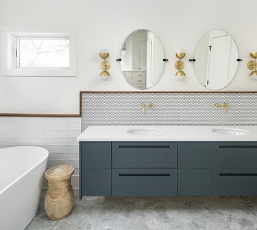 framed mosaic tile bathroom backsplash idea in modern space with midcentury lighting