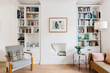 bookshelves in a living room with hardwood floors