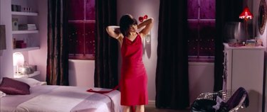 assistant mia taking off dress, still frame from love actually apartment