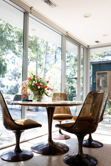 circular dining table with chairs on cork flooring