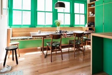 green kitchen with hardwood floors