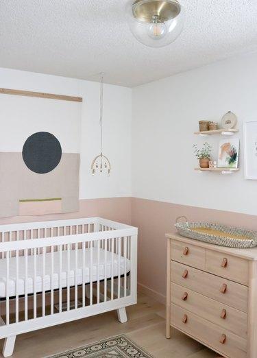 white and pink modern nursery idea with modern boho decor