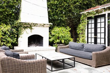 outdoor fireplace, couches and table