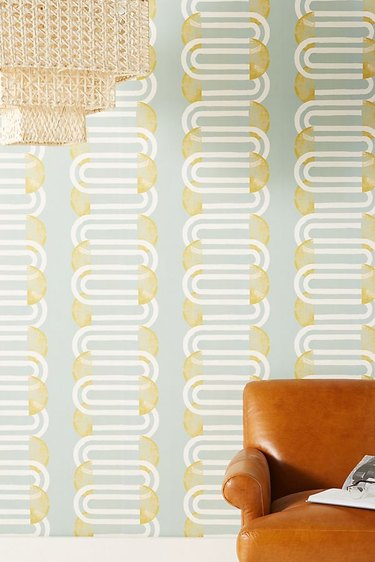 Blue, yellow, and white midcentury modern wallpaper with half circles