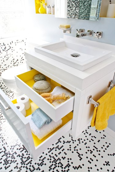 blue bathroom with black and white mosaic floor tile