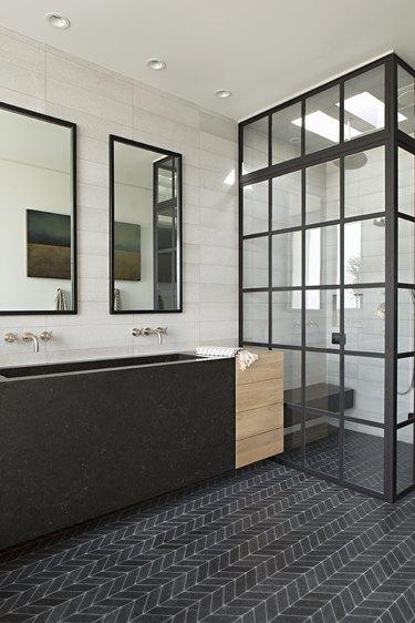 modern industrial bathroom with chevron mosaic bathroom floor tile and trough sink