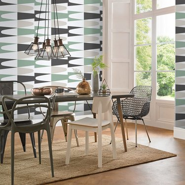 Green, brown, and white midcentury modern wallpaper in dining room