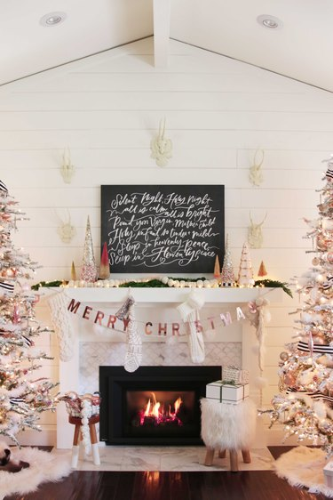 farmhouse Christmas decorating idea with fireplace mantle with rose gold decorations and Christmas trees