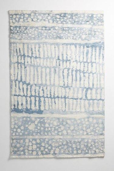 light blue tufted rug