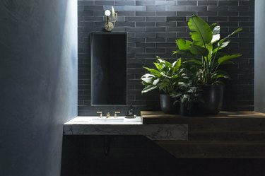 Black bathroom backsplash idea with with custom vanity