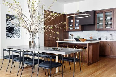 open kitchen with dark wood cabinets and modern chandelier