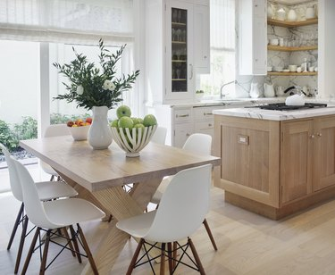 kitchen space with wood table and white chairs
